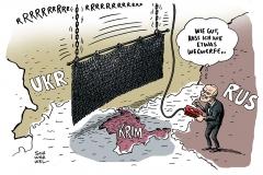 schwarwel-karikatur-krim-ukraine-eisernervorhang-putin