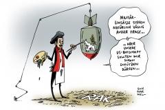 schwarwel-karikatur-obama-us-usa-krieg-irak-botschaft-frieden